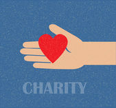 Hand holding the heart. charity — Stock Vector