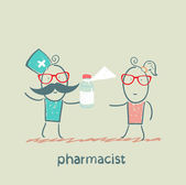 Pharmacist giving medicine to the patient — Stock Photo