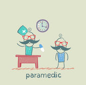 Paramedic tablet gives a patient — Stock Photo