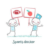 Sports doctor holds a banner with a painted apple and next man holds a poster with a soccer Ball — Stock Vector