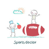 Sports doctor giving an apple to the person who sits on a huge soccer ball — Stock Vector