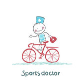 Sports doctor rides a bicycle — Stock Vector