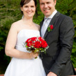 Newly married couple with red roses — Lizenzfreies Foto