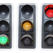 Traffic lights showing red green and red isolated — Stock Photo
