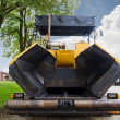 Tire asphalt paver - Stock Photo