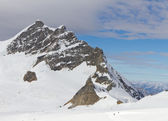 Mountain Jungfrau and mountain station Sphinx — Stock Photo
