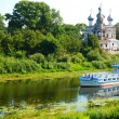 Ferry goes by river in Vologda, Russia - Stock Photo