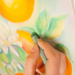 Artist at work with pastel painting — Stock Photo