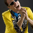 Stock Photo: Rockabilly singer from 1950s in yellow jacket