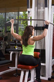 Muscular woman in the gym — Stock Photo