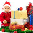 Baby with christmas gifts — Stock Photo #15649377