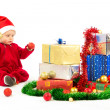 Stock Photo: Baby with christmas gifts