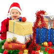 Baby with christmas gifts — Stock Photo