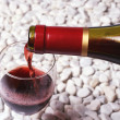 Red wine on the white stone. — Stock Photo