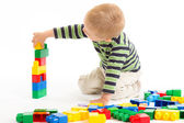 Little cute boy playing with building blocks. Isolated on white. — Stock Photo