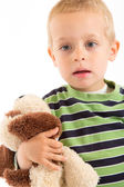 Little boy with his plush puppy. Isolated on white. — Stock Photo
