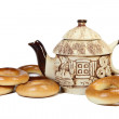 Ceramic teapot with bread-rings — Stock Photo