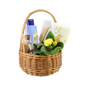 Bath accessories in the basket isolated on white — Stock Photo