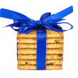 Stock Photo: Stack of raisin cookies with blue ribbon isolated on white