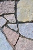 Stone fence background, vertical stonewall closeup, decorative limestone slate slab rock — Stock Photo