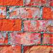 Light red brick wall texture macro closeup, old detailed rough grunge cracked textured bricks copy space background, grungy weathered stained vintage brickwork cut vertical pattern — Stockfoto