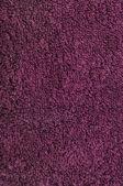 Banyo havlusu, koyu kırmızı, pembe, asma, ahududu, kırmızı, doğal peluş havlu kumaş Türk beach kumaş makro arka plan closeup doku dikey ışıma dokulu — Stok fotoğraf
