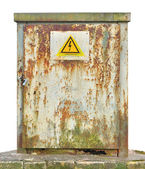Power distribution wiring switchboard panel outdoor unit, old aged weathered vintage grunge rust distributing board compartment box cabinet, yellow high voltage warning sign, isolated grungy closeup — Stock Photo