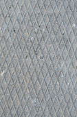 Old grey weathered concrete plate rough grunge abstract cement tile texture diagonal groove pattern macro closeup, diagonally grooved vertical textured gray walkway background stained vintage sidewalk — Stock Photo