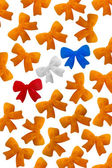 A lot of orange bows — Stock Photo