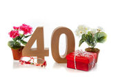 Celebrating your Fourtieth birthday, getting presents like reading glasses and a begonia — Stock Photo