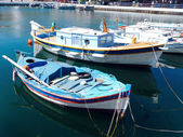 Beautiful view of boats on the lake voulismeni in greece — Stock Photo
