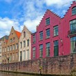 Traditional flemish houses near canal in Bruge, Belgium — Stock Photo #14873145
