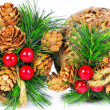 Two christmas balls decorated with cones and winterberries isola — Stock Photo