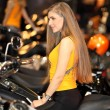 MOSCOW, RUSSIA, MARCH 2013, 10th International Motorcycle Exhibition MOTOPARK, Beautiful woman on motorcycle — Stock Photo #21758715