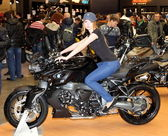 MOSCOW, RUSSIA, march 2013, 10th International Motorcycle Exhibition MOTOPARK, Beautiful girl on motorcycle — Stock Photo