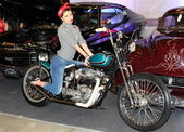 MOSCOW, RUSSIA, march 2013, 10th International Motorcycle Exhibition MOTOPARK, Beautiful girl on motorcycle — Foto de Stock