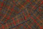 Fragmento do velho casaco de tweed como pano de fundo — Fotografia Stock