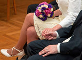 Bride and groom holds their hands — Stock Photo