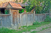 Old wooden carved gate in Transylvania — Stock Photo