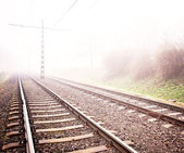 Railway track in heavy fog — Stockfoto