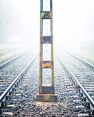 Railway track in heavy fog — Foto Stock