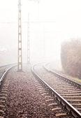 Railway track in heavy fog — Stock Photo