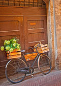 Bicycle near house — Stock Photo