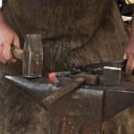 Blacksmith forged iron smith anvil hammerman — Stock Photo #47695727