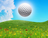 Golf ball in the air on a sunny day — Stock Photo