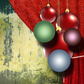 Christmas balls with red curtain on grunge background — Stock Photo
