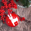 Christmas ball decoration with deer and red berry — Stock Photo