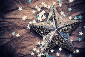 Silver stars over old vintage paper — Stock Photo
