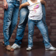 Studio shot of family of three wearing blue jeans — Stok fotoğraf