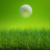 Golf ball on lawn over green — Stock Photo